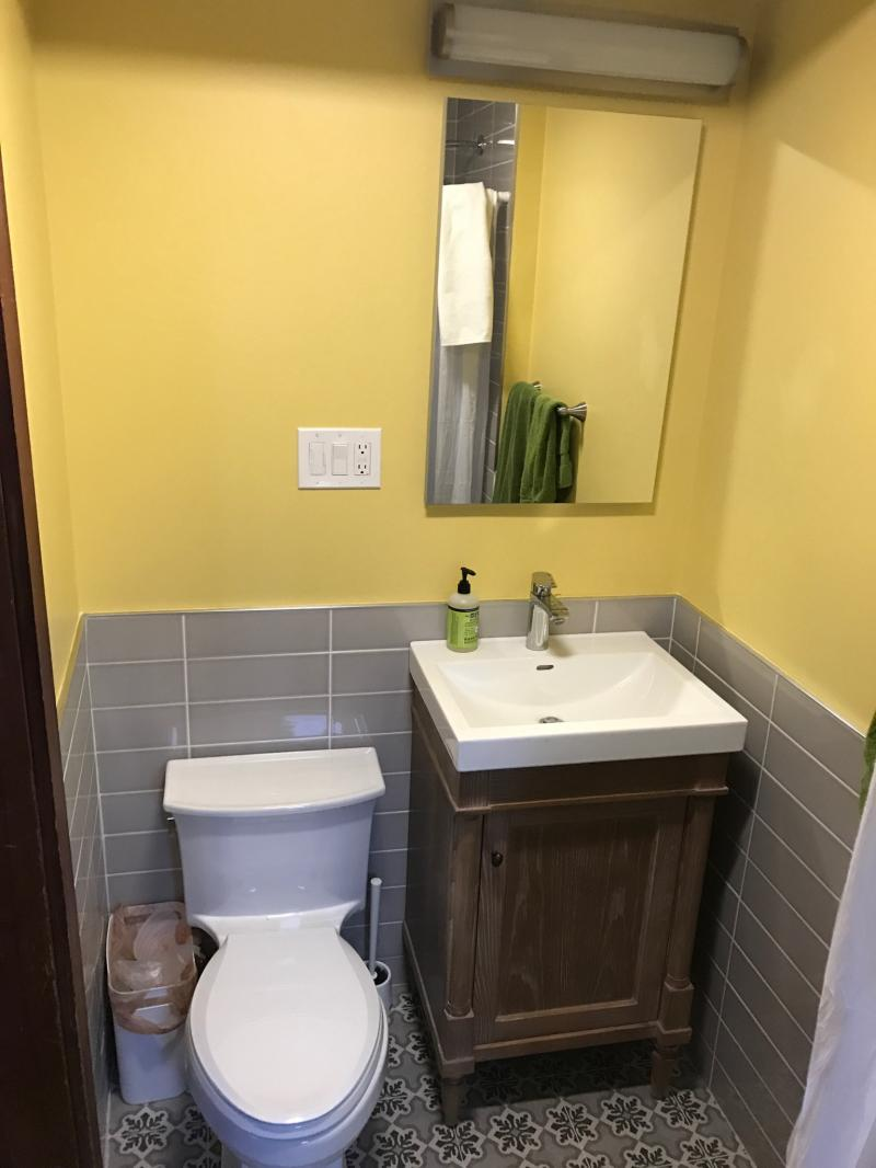 From a small walk-in closet to a functional bathroom, complete with shower!